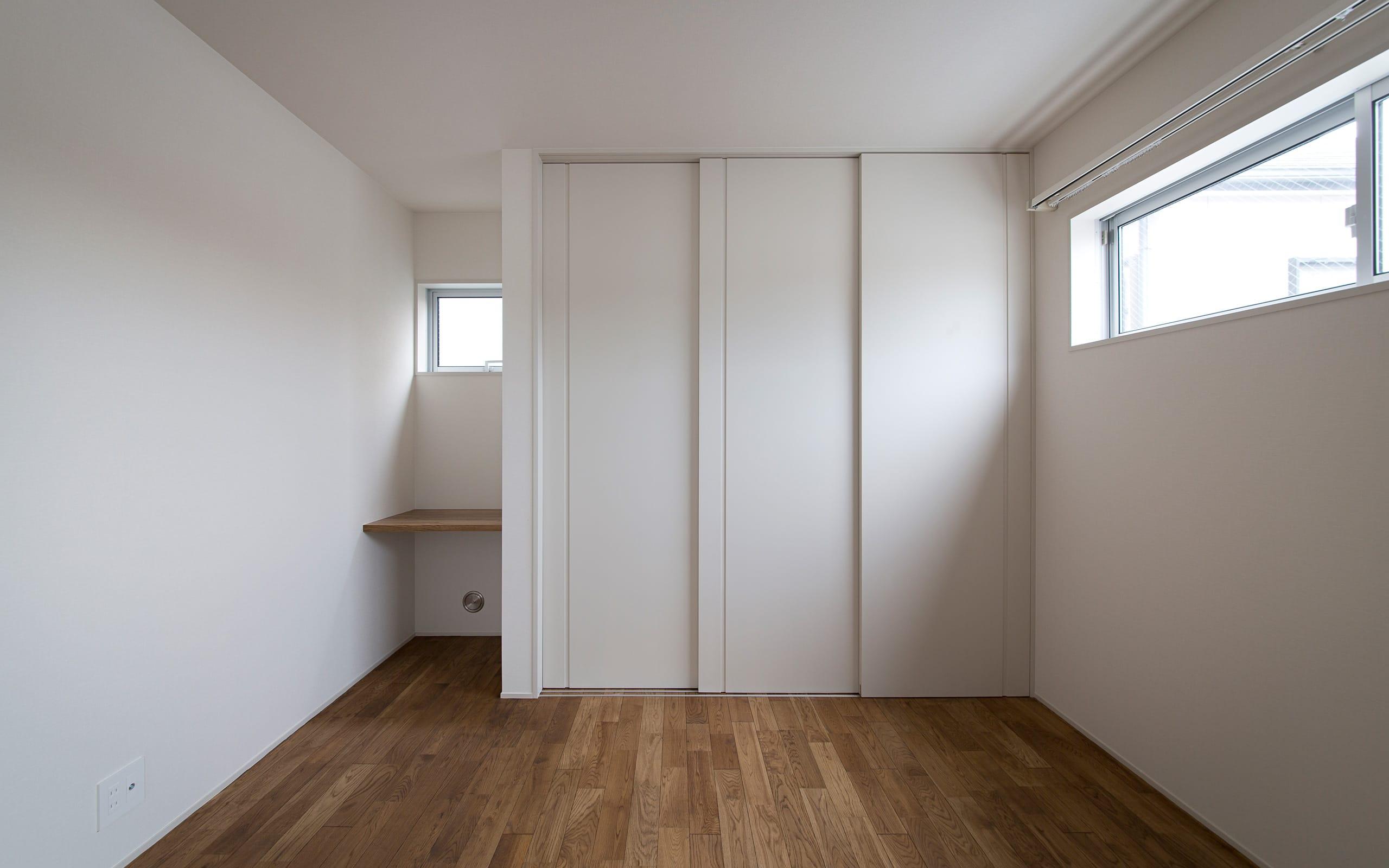 吹抜けリビングのある住宅の部屋1